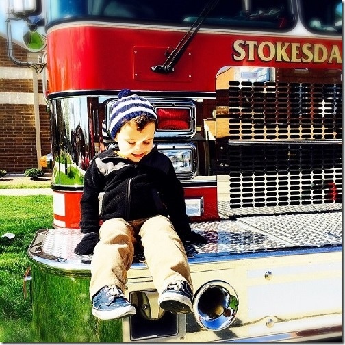boy on fire truck