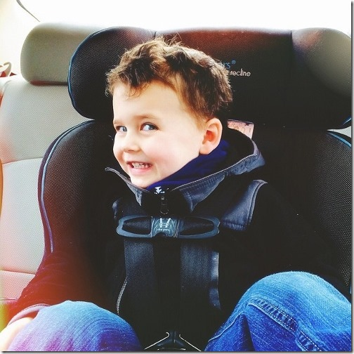 goofy kid in car seat