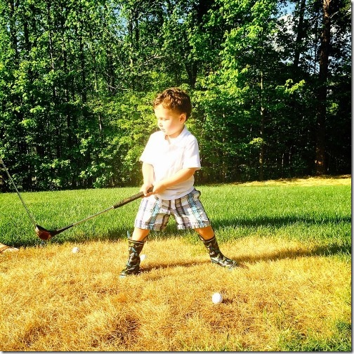 three year old playing golf