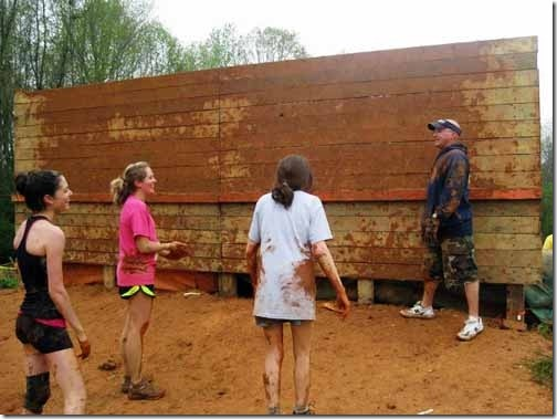 muddy wall on obstacle course