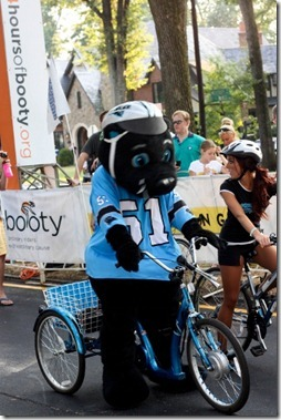 sir purr rides his tricycle
