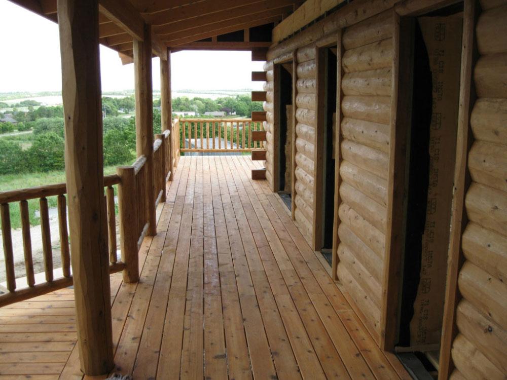 denmark-half-log-siding-cedar-porch-and-cedar-deck-railing