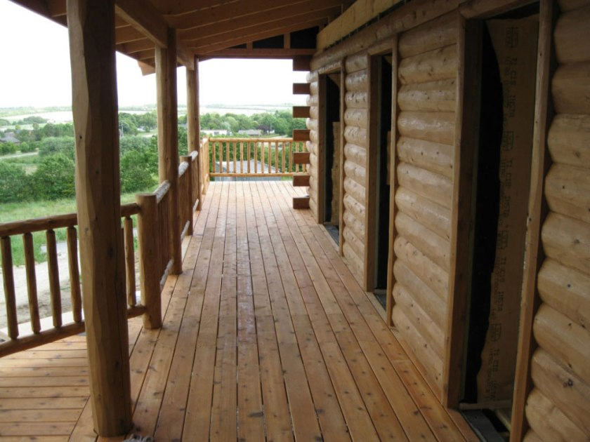 denmark-half-log-siding-cedar-porch-and-cedar-deck-railing