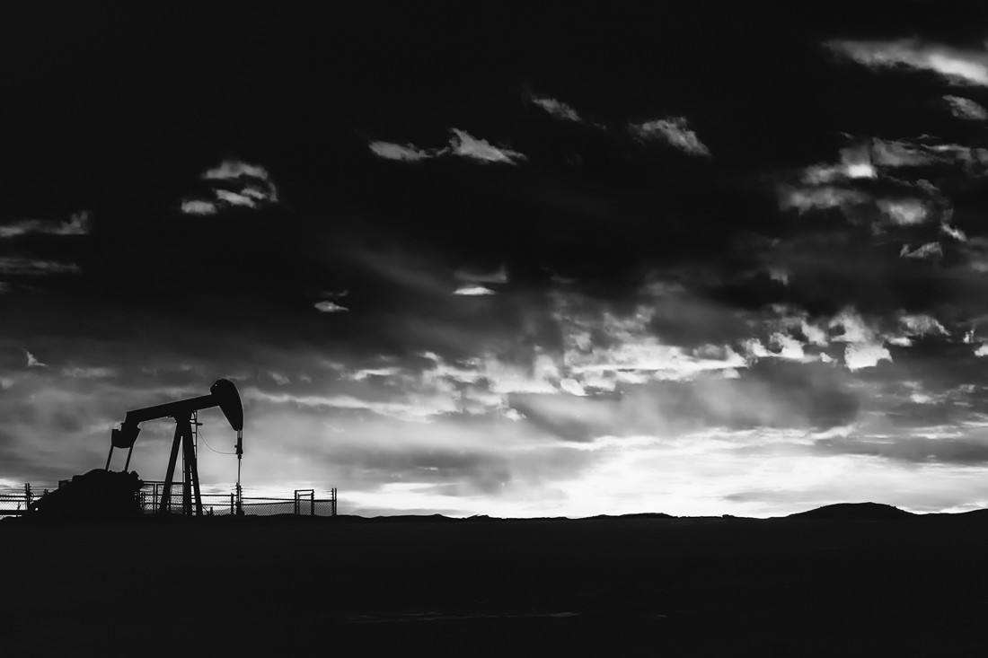 Working pumpjack in rural Alberta during a mid-winter sunrise, Alberta Oil and Gas.