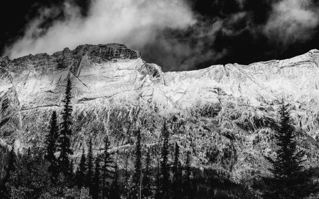 Colin Range covered in snow during an early autumn day in the Canadian Rockies, black and white fine art Alberta landscape.