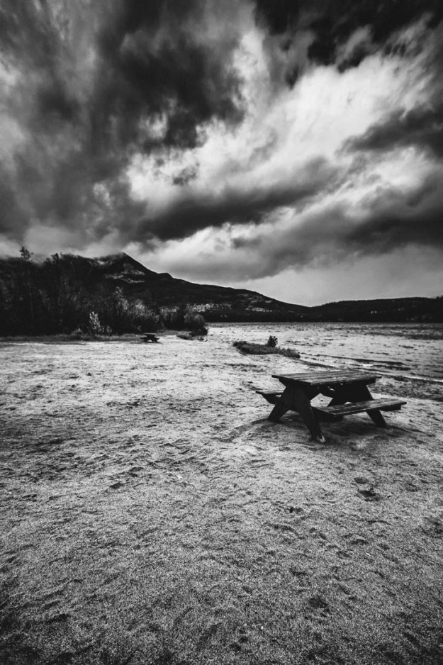 Picnic benches scattered on the beach along Jasper during an early autumn stormy afternoon.