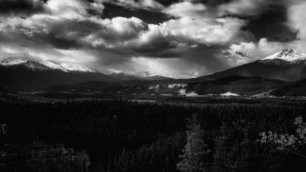 Cloudy afternoon overlooking the valley in the Canadian Rockies, black and white fine art Alberta landscape.