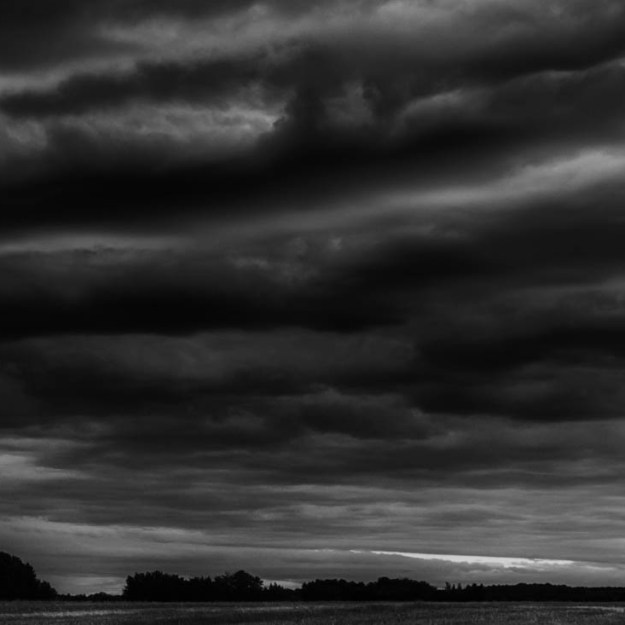 Stormy skies on the Alberta prairies during a late spring early morning, Black and white fine art Alberta landscape.