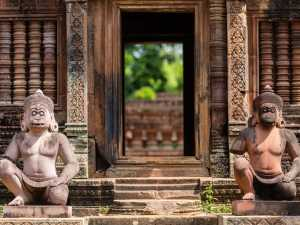 entrance of Beng Mealea temple with two ancient statues