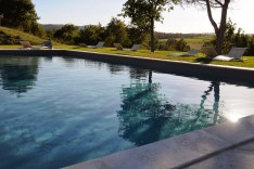 the stone surround of the pool is made of local travertine marble