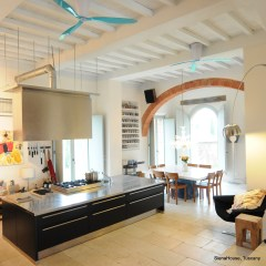 Image of the kitchen on the ground floor showing beamed ceilings and arches