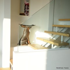 Image of the stairs up to the storm gallery showing a chocolate coloured hare made in Ceramic Sculpture by amanda helen atkins