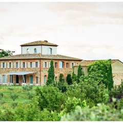 Image showing a stone and brick tuscan farmhouse on a hill with a shaded seating area with views an unrestored out building and terraced garden of olive groves photo by Rene Rickli