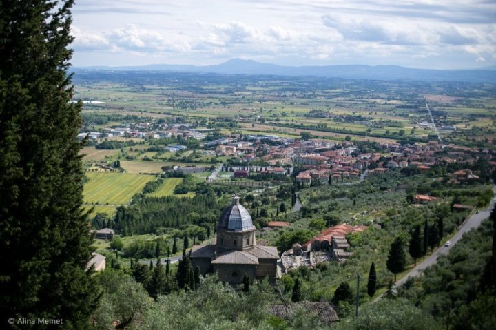 Image showing a dome viewed from above this is the dome at cortona and the view beyond is the val di chiana countryside.