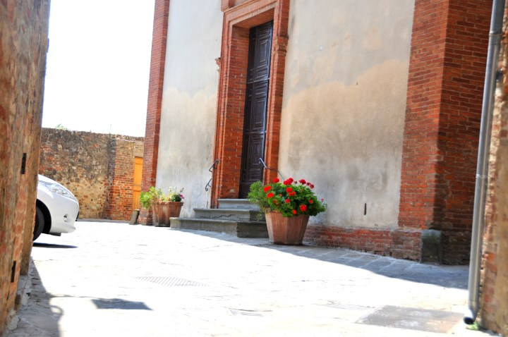 Image showing a Valdichiana Tuscan hill town chapel with potted Geraniums outside