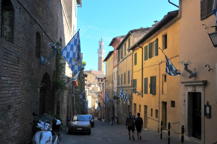Image showing the streets of Siena with contrada flags flying