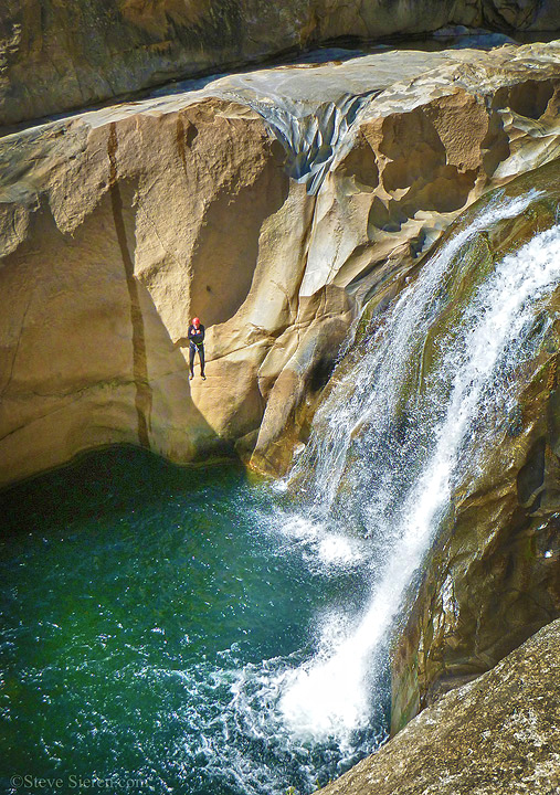 Canyoneer makes a 40ft jump in a very remote section of Jump Canyon in Sierra Nevada Foothills of California