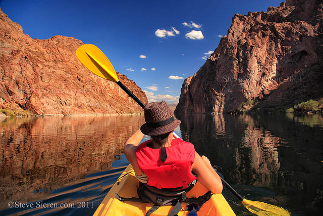 Christina kayaking down the Colorado River in the Mojave Desert