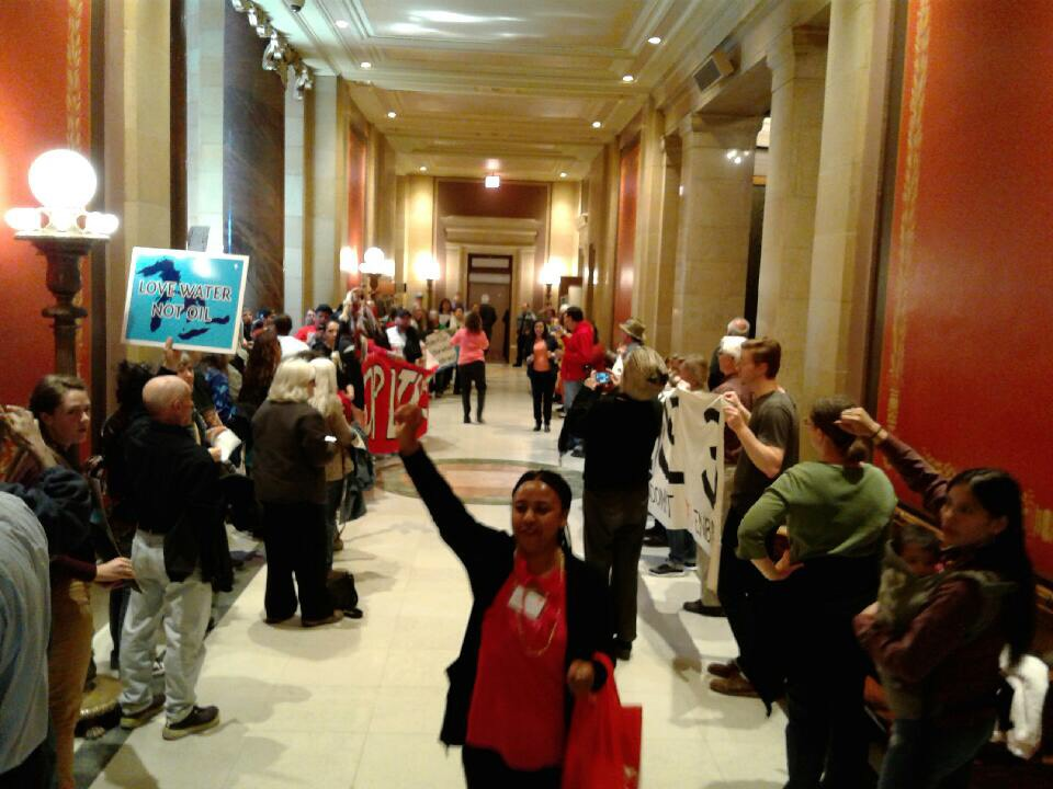 People rallied outside the Minnesota House Chamber with signs, drums, chanting and prayers, opposing the Enbridge Line 3 Pipeline and the Energy bill that supports it. They left a path for House members to get to the chamber.