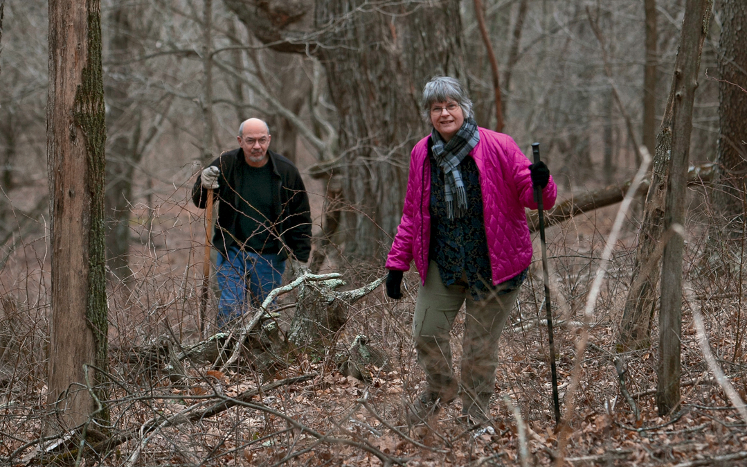 Lynn Limbert walk their property near the western edge of the George Washington and Jefferson National Forests. This swatch of virgin timber lies in the pipeline's path.