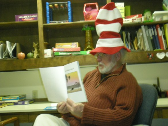 Jim Johnston reads in a relaxed manner
