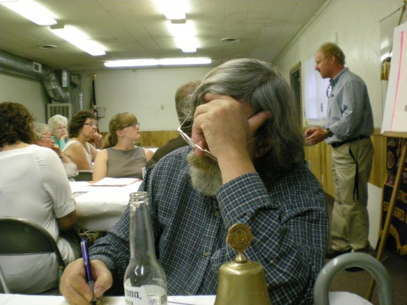 Attempting to hide his whereabouts Don Russell gives it away by the Downieville Lion's Club official bell on the table in front of him....