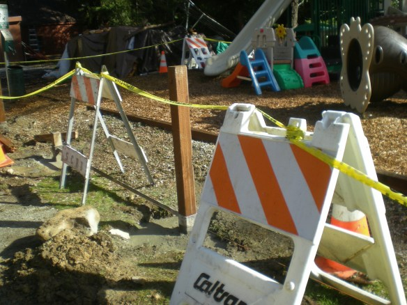 According to the barriers, SCRD, CalTrans and PG&E all got together to help keep our tots safe on the Playground next to the Tennis Courts... thanks everyone.