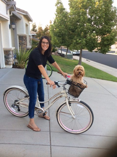 Former Downieville Schools Student, School Secretary, still the daughter of David & Carol Marshall, wife of Brandon Pangman, mother of Tanner and Mason, owner of Liz Fisher's bike and dog transporter Suzi Marshall.