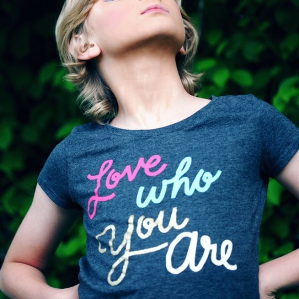 Elementary age girl in grey t-shirt says love who you are