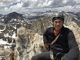 Ney on the summit of the Hulk in July, with Yosemite north border zone in background.