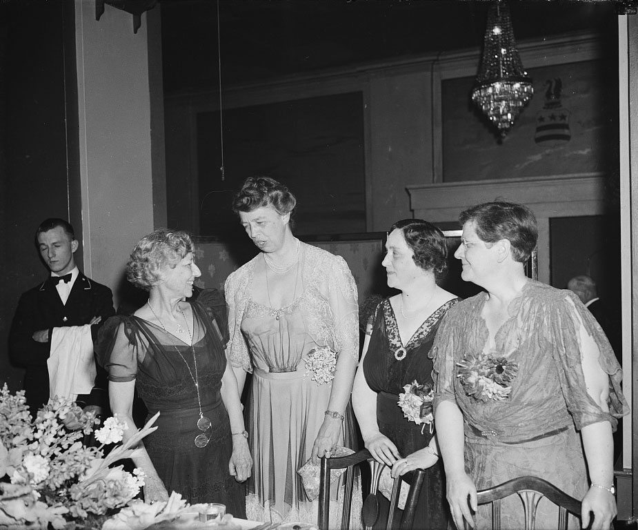 Democratic and Republican lady voters talk things over. Washington, D.C. April 26, 1939. The National League of Women Voters General Council Dinner 'The Liberty we prize' had as its guest speakers the outstanding ladies of both parties. L to R: Miss Marguerite M. Wells, President; Mrs. Franklin D. Roosevelt, First Lady; Mrs. Robert A. Taft, Toastmistress; and Judge Florence E. Allen - image - Harris & Ewing, Library of Congress.