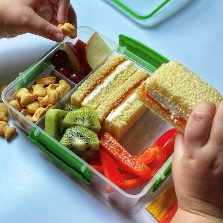 cheddar goldfish and sandwich snacking