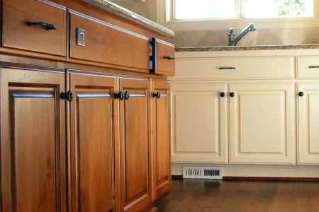 A run of custom alder kitchen cabinets and painted cabinets