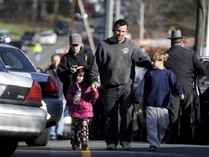 At Sandy Hook, parents and others lead children to safety and comfort.