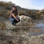 Phoebe Prather and Jake greet the first trickle of water in the Lower Owens River in November of 2006, when water was returned to the formerly dry streambed. Note the tumbleweeds, dead trees and bone dry riverbed. Today, water has brought new life to 62 miles of the Lower Owens River. Photo by Mike Prather.