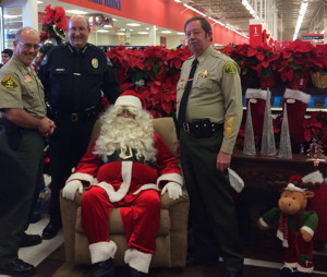 (l-r) Mono Sheriff Ralph Obenberger, Mammoth Police Chief Dan Watson, Santa and Inyo Sheriff Bill Lutze.