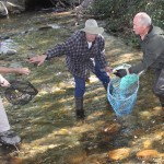 Jeff O'Brien, Robert Atley and Ken Lyndes gathering up the winning ducks at last year's ducky derby.