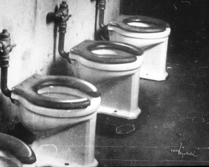 Photo Caption: Archie Miyatake photographed the interior of Manzanar's Block 20 men's latrine in 1944. Photo Credit: Toyo Miyatake Studio