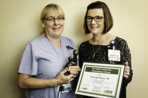 NIHD's 2016 DAISY Award winner Rhonda Aihara with Acting Chief Nursing Officer Tracy Aspel. Aihara was selected for the honor from a field of 10 nominees. Photo by Barbara Laughon/Northern Inyo Hospital