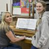 Maryanne Schat as Donna and Abby Stoiber as Sophie rehearsing for Mamma Mia!