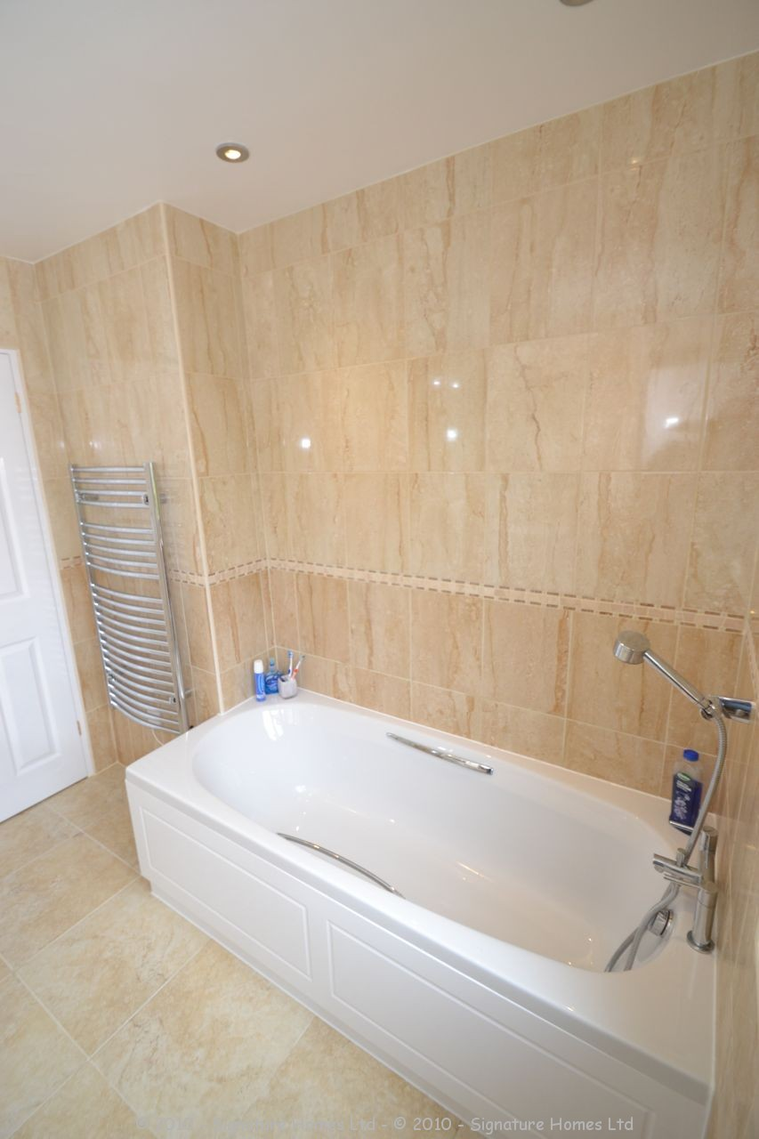 Fitted Bathroom with knock through in Banstead - 7