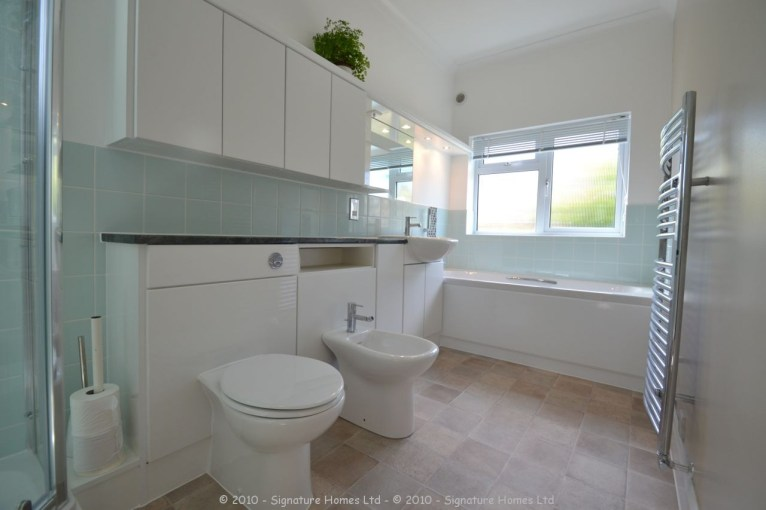 Light & Spacious Fitted Bathroom with pentagon shower enclosure - Woodcrest Road Purley 1