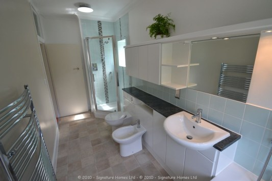 Light & Spacious Fitted Bathroom with pentagon shower enclosure - Woodcrest Road Purley 3
