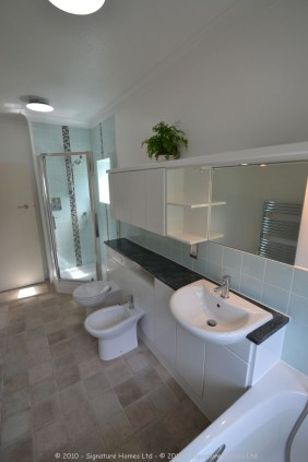 Light & Spacious Fitted Bathroom with pentagon shower enclosure - Woodcrest Road Purley 10