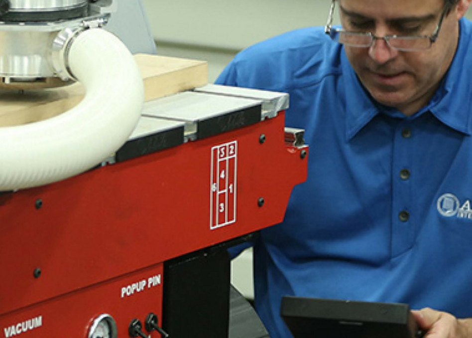 cnc router being maintained