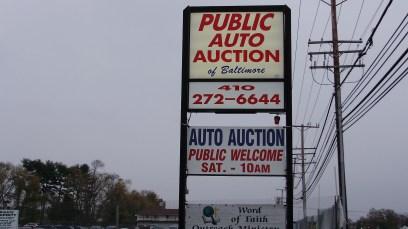 Public Auto Auction pylon sign