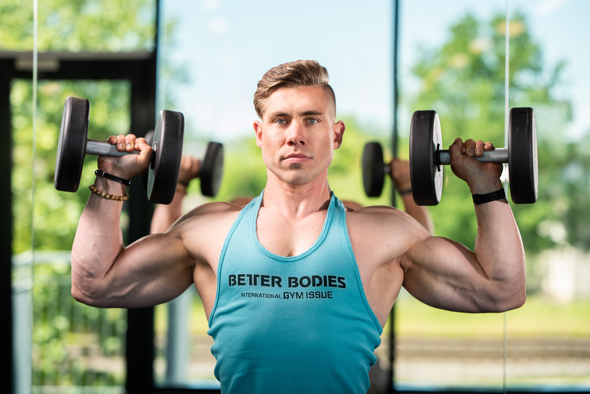 Egert Oiov showing the dumbbell overhead press