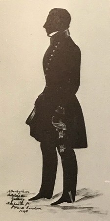 Silhouette of a naval officer holding a sword