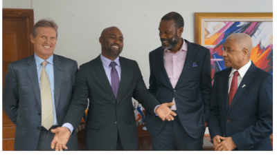 CAPTION: Cable and Wireless Communications CEO Phil Bentley, Minister of Science, Energy and Technology Andrew Wheatley, FLOW Managing Director Garfield Sinclair and FLOW Foundation Executive Chairman Errol Miller during a meeting at the ministry on May 11, 2016. PHOTO COURTESY Jamaica Ministry of Science, Energy and Technology.