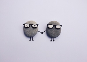 two pebbles with glasses